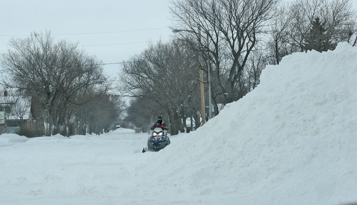 A snowmobiler negotiates the streets of Crosby, North Dakota. Photograph courtesy of the Crosby Journal.